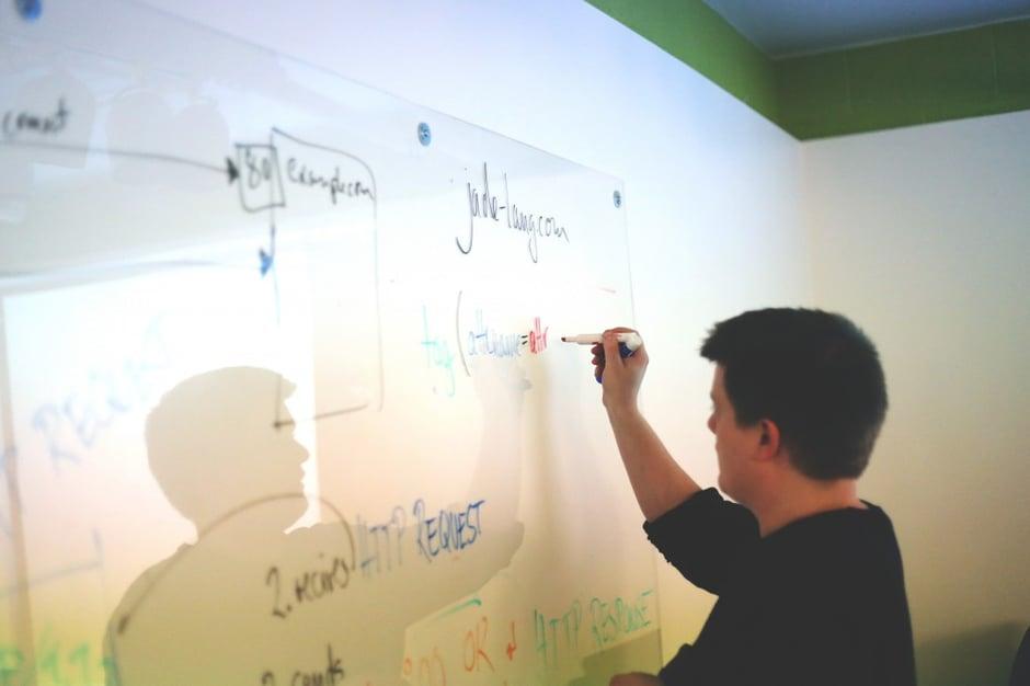 man-writing-whiteboard
