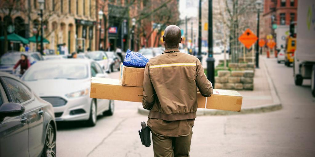 man-carrying-parcels