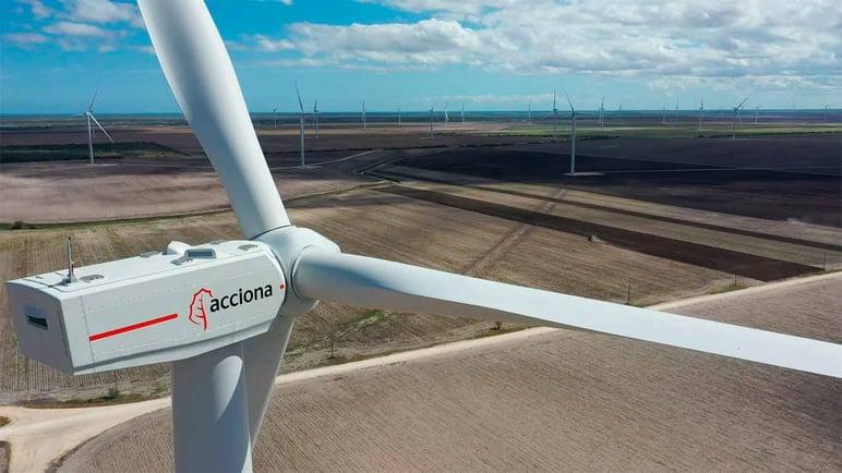 Wind turbine with Acciona logo in a landscape